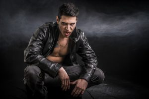 Young Vampire Man in an Open Black Leather Jacket